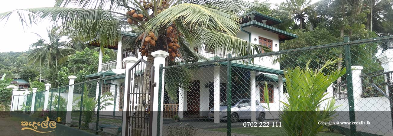 House building contractors in Kandy Sri Lanka done fully completed two storey house and green fence
