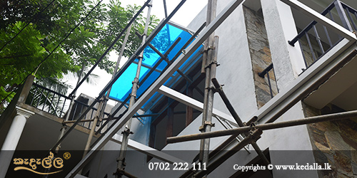 House construction company uses scaffolding: a temporary movable structure made of wooden planks/metal poles